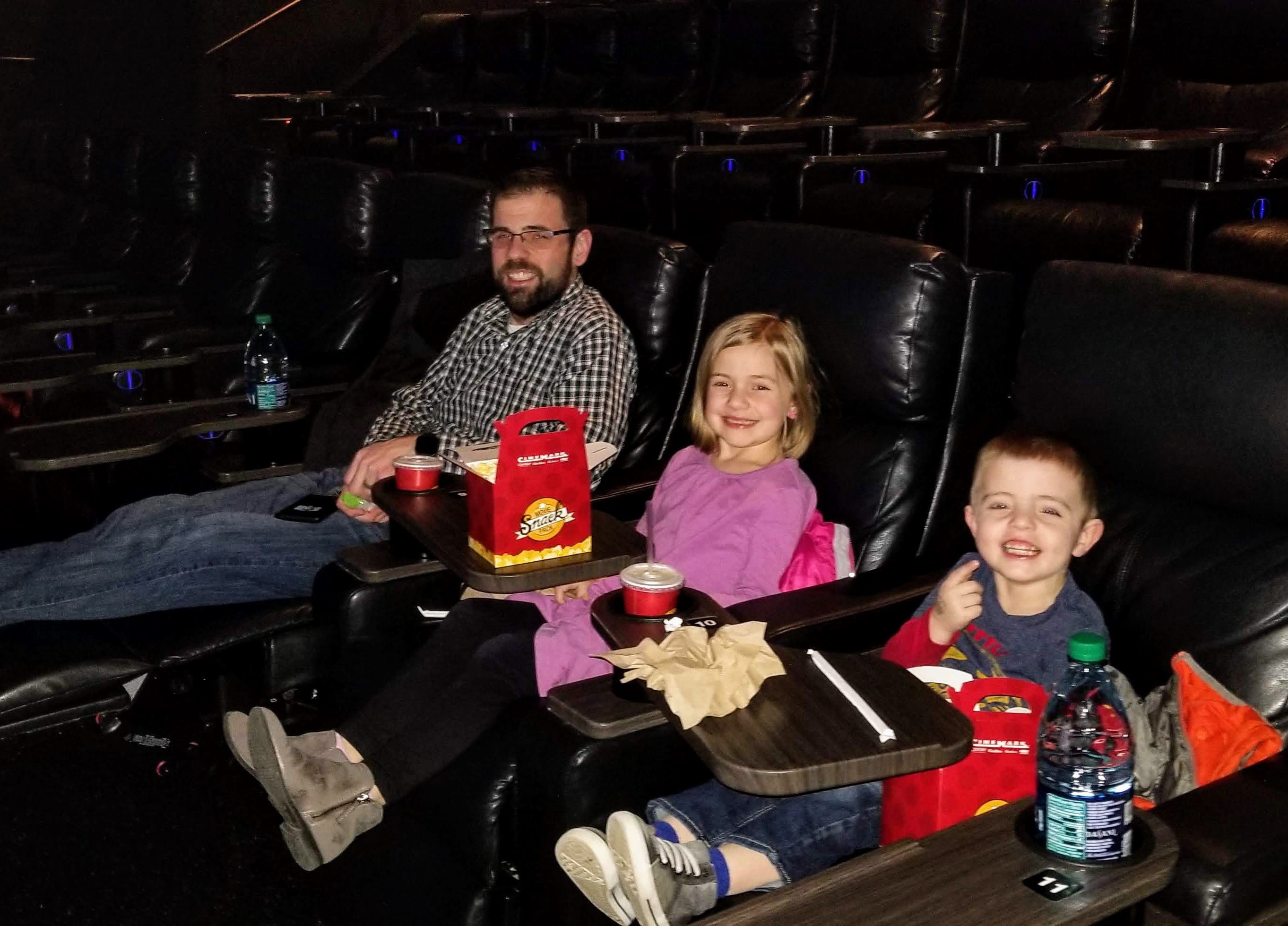 The family at a late night movie showing in an empty theater