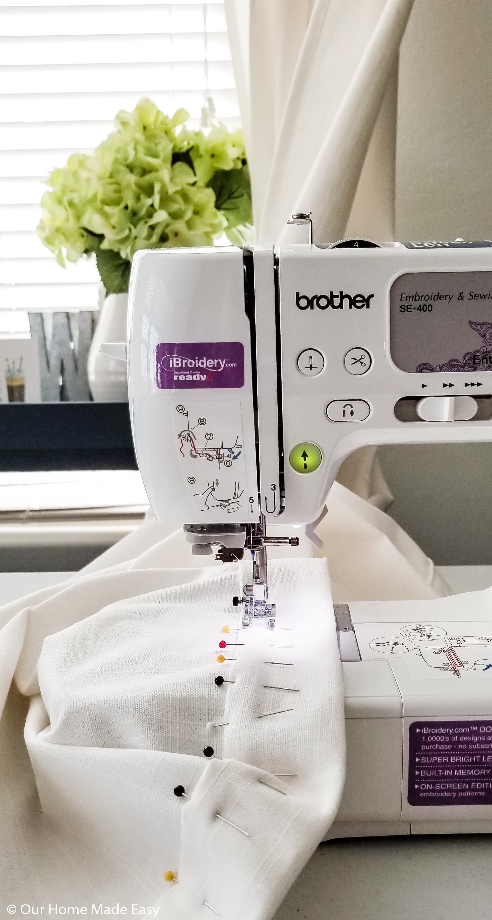 Bust out your sewing machine to hem your DIY curtains to your preferred length