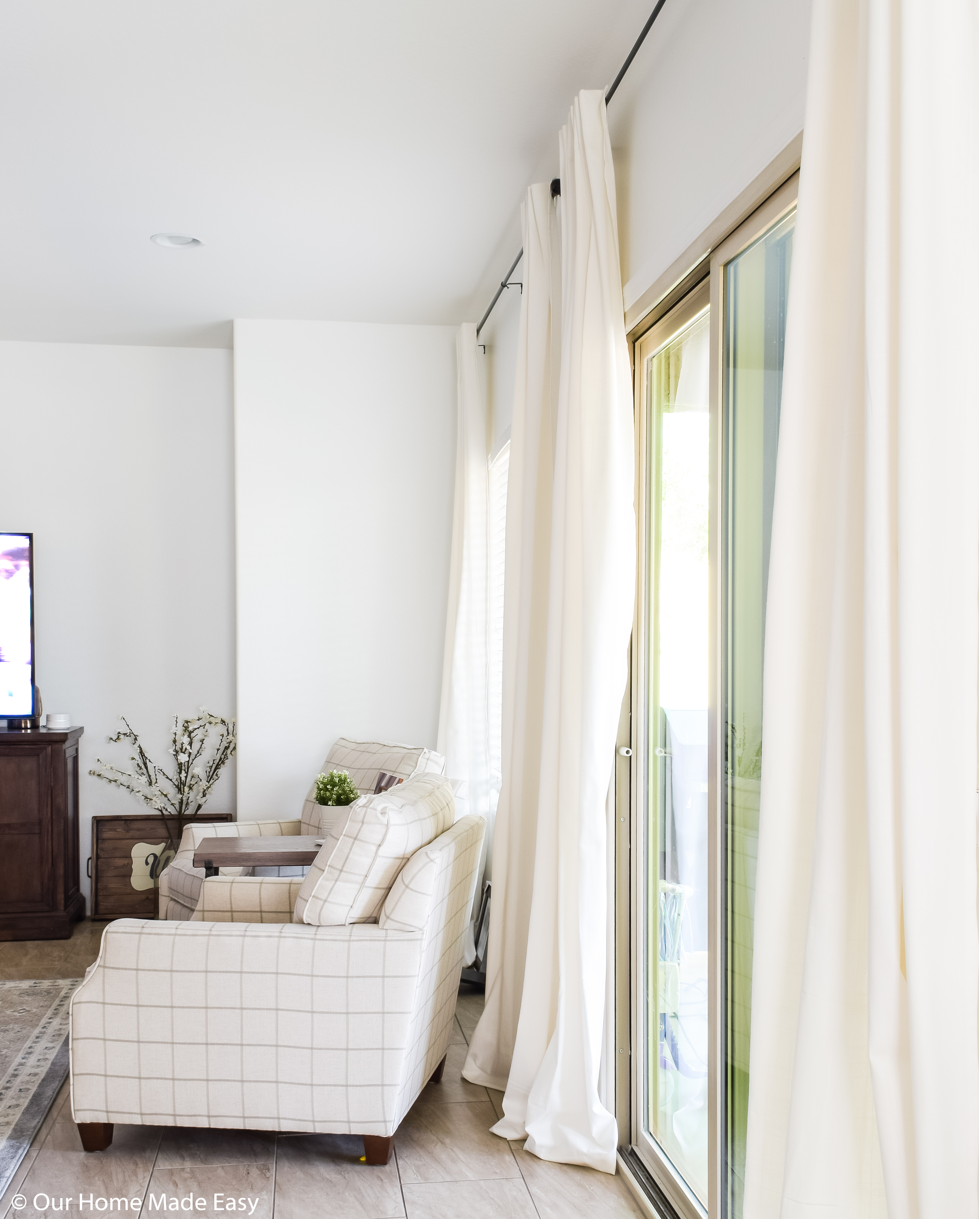 I love our extra-long hanging curtains! They make the room feel tall and full of light
